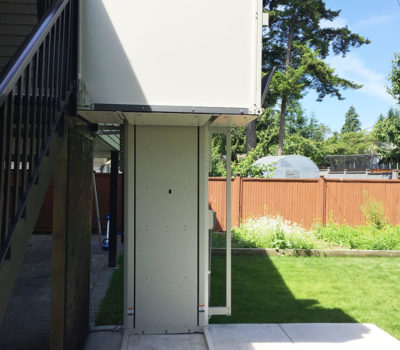 Vertical Platform Lift Installed Outside House